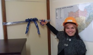 Legislature secretary Gerrie Willemse cuts the ribbon to our new loo