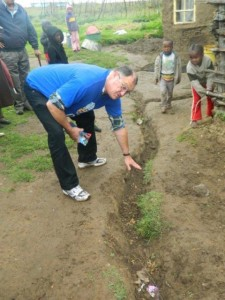 Shadow MEC for Local Government, Dacre Haddon (MPL) inspects a makeshift trench used to lead sewage away from the homes of residents in the Zolani informal settlement with Grahamstown.