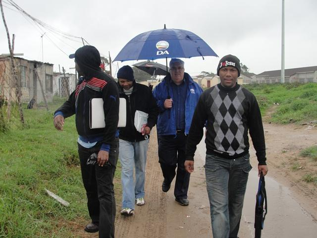 DA Leader in the Legislature Bobby Stevenson (with the umbrella) embarked on a door-to-door campaign in Walmer Township in Port Elizabeth on 10 May.  With him, from the left, are DA-activists Makhalima Khaya, Daliwonga Tesana and Lubabalo Kona.