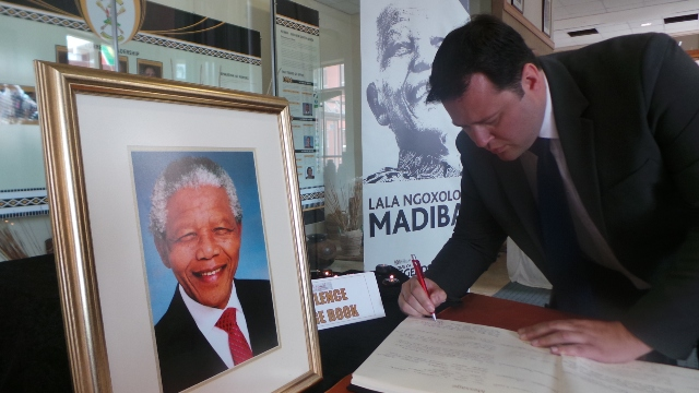 DA MPL John Cupido signs the Book of Condolence during a special sitting of the Eastern Cape Provincial Legislature on Monday, 9 December 2013, in honour of former President Nelson Mandela.  Picture:  Cecile Greyling