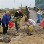 Legislature Leader Bobby Stevenson, taking part in a beach clean-up