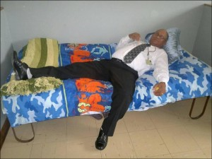 Light moment...DA education spokesperson Edmund van Vuuren takes a breather in a sleeping unit supplied to exhausted markers at the Matric Marking Centre in Mthatha.