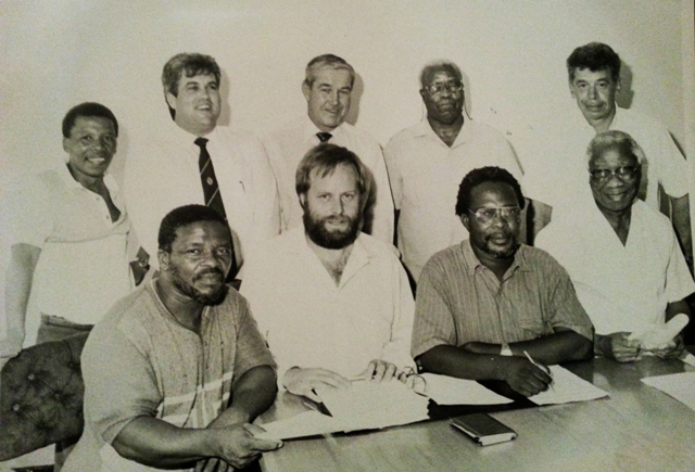 History of freedom:  Bobby Stevenson, Legislature Leader (back, second from the left) with ANC-stalwarts Raymond Mhlaba (back, second from the right) and Govan Mbeki (front right) pictured on 3 April 1991, when the DP and ANC signed the historic One City Agreement for a non-racial city council, that heralded the way for Port Elizabeth to become the first transitional local council in South Africa.  ** See article 'Rainbow nation novelty worn off' on this page.