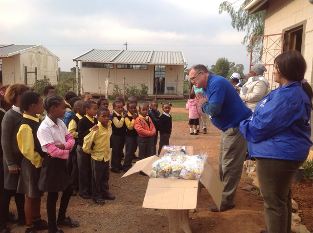 """Dacre Haddon, DA member of the Eastern Cape Provincial Legislature yesterday (subs:  Thursday, 18 July) visited the Glenconner Primary School in the Sunday's River Valley, where he told the 53 learners about the legacy of Tata Mandela.  After the national anthem the children also sang """"Happy Birthday Dear Madiba"""".  Each child received a tuck-parcel and a slice of birthday cake.  Local DA councillor Isobel Wagenaar accompanied Haddon.   Photo:  Karen Smith"""
