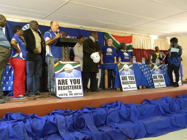 A membr of the ANC can be seen on the stage on the far right of this picture, taken during a DA rally in Ngqeleni on Saturday, 21 September.  Memeber of the ruling party attempted to disrupt the meeting by marching to the hall, getting onto the stage and making allegations of violence by DA members.