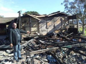 Caption: A school in ashes: DA MPL Edmund van Vuuren points out the burnt structure of what once was Jubilee Park Primary School in Uitenhage following a fire that broke out on 19 May 2013.