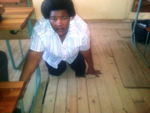 Louis Rex Primary school teacher Florence Njara-Swapi was photographed by a colleague where she got stuck after stepping through the floorboards in her classroom.